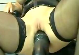 perverted leather milf marian rides massive dildo