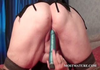 golden-haired mature tramp licking her large