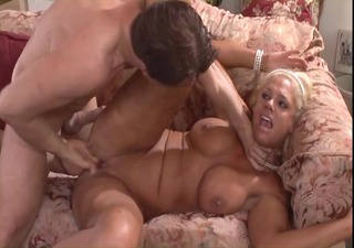 blond cougar with big tits rides a juvenile cock